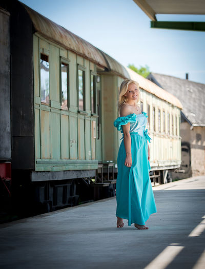 beautiful woman on the platform Adult Architecture Backgrounds Blue Building Exterior Day Fashion Full Length Lifestyle Lifestyles Long Dress Looking At Camera Natural Beauty One Person Outdoors People Portrait Real People Sexygirl Sexywoman Standing Young Adult Young Women