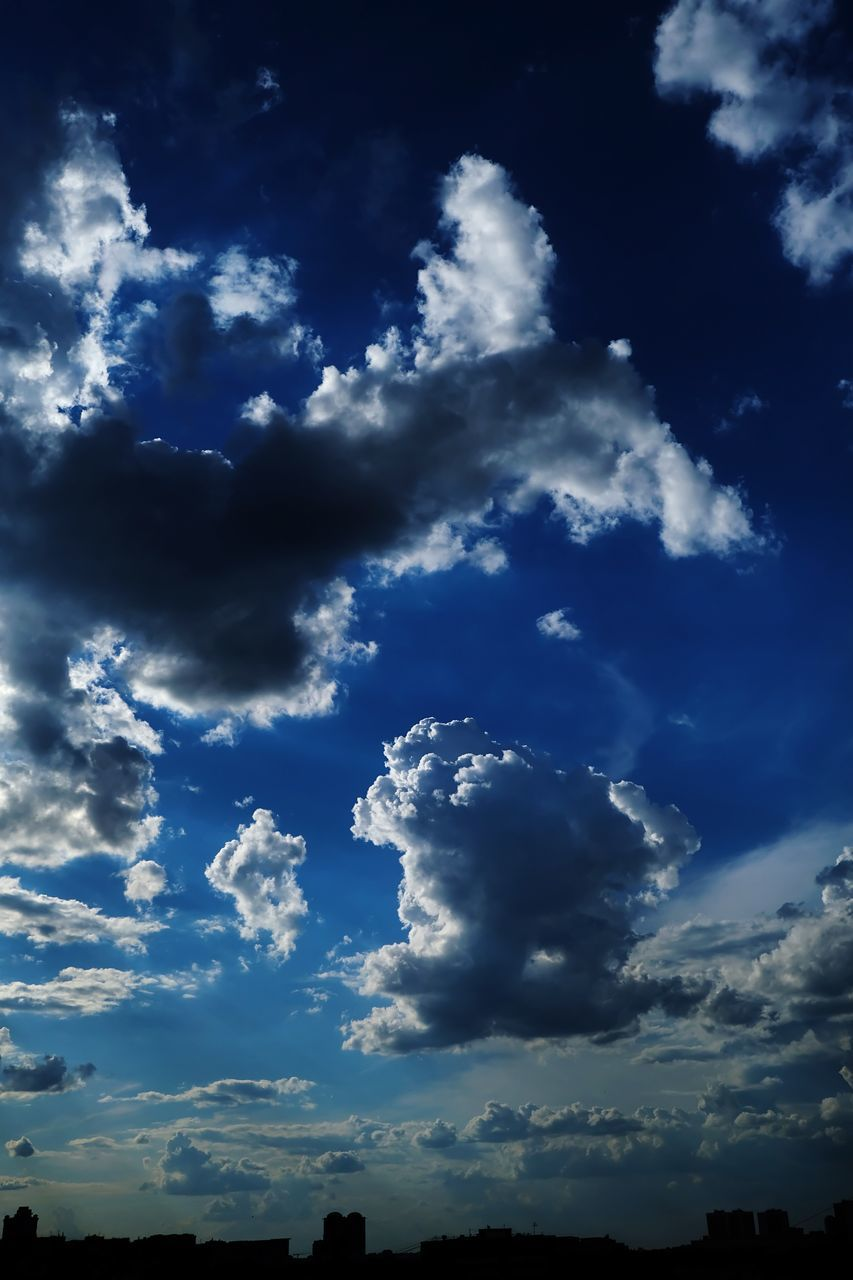 cloud - sky, sky, beauty in nature, low angle view, tranquility, nature, scenics - nature, no people, blue, tranquil scene, outdoors, day, sunlight, idyllic, cloudscape, dramatic sky, backgrounds, overcast, architecture, meteorology
