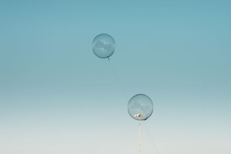 Tranquil Scene Tranquility Childhood Simplicity Urban City Low Angle View No People Nature Blue Balloon Sky Drop Indoors  Transparent Clear Sky Light Bulb Motion Mid-air Lighting Equipment Bubble Copy Space Electricity  Blue Background Purity Copy Space Minimalism Reflection Flying Floating 17.62° The Creative - 2019 EyeEm Awards The Minimalist - 2019 EyeEm Awards