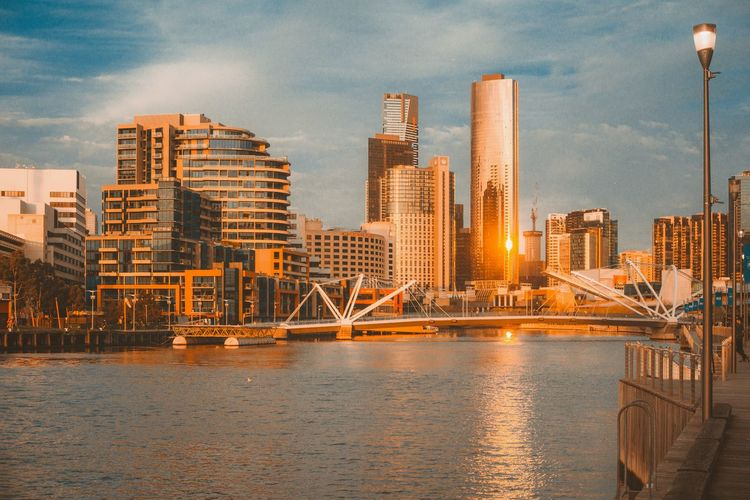 EyeEm Selects City Cityscape Urban Skyline Water Modern Illuminated Skyscraper Sea Sunset