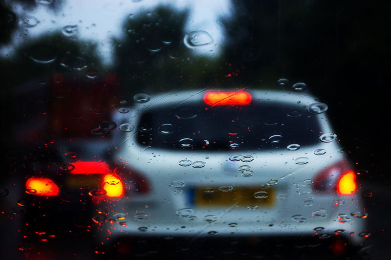 Rainy Driving Rain Driving Wet Water Droplets Storm Car Lights Southsea Hampshire  England Water Land Vehicle Red Backgrounds Car Wet Drop Window Illuminated Close-up