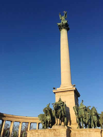 Hero's Square EyeEm Selects Budapest Sky Travel Destinations Architecture Sculpture Built Structure Travel Blue Low Angle View Human Representation Architectural Column Art And Craft Representation Clear Sky The Past Statue History Nature Memorial Tourism Day