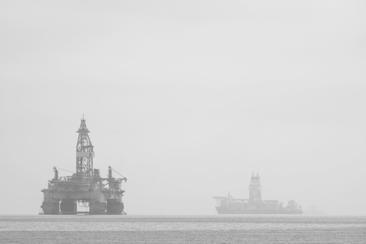 copy space, waterfront, architecture, water, fog, day, sea, outdoors, travel destinations, transportation, nautical vessel, built structure, no people, lighthouse, building exterior, nature, sky, offshore platform, drilling rig