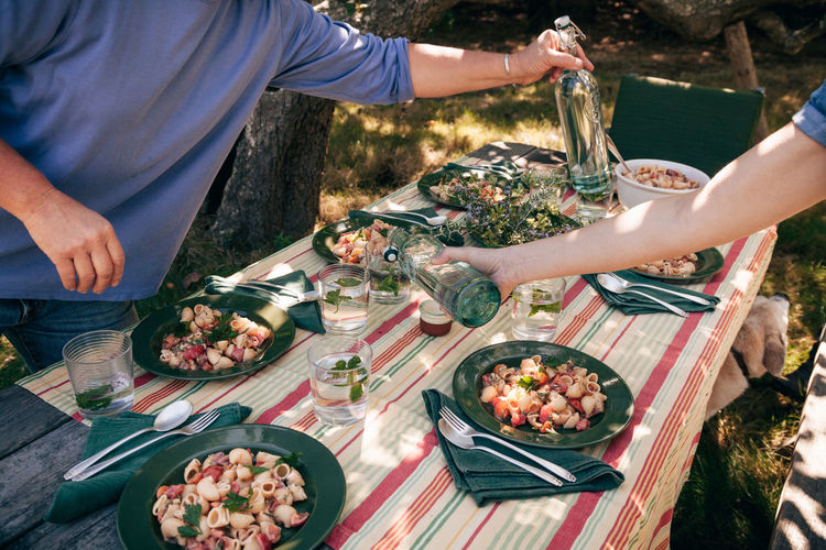 Casual Lunch Barbecue Bowl Celebration Drink Food Food And Drink Freshness Friendship Healthy Eating Outdoors Party - Social Event Pasta Picnic Plate Real People Serving Size Table Togetherness