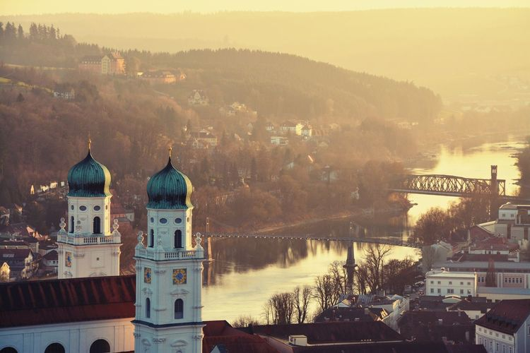 St stephen cathedral by inn river in passau during sunset