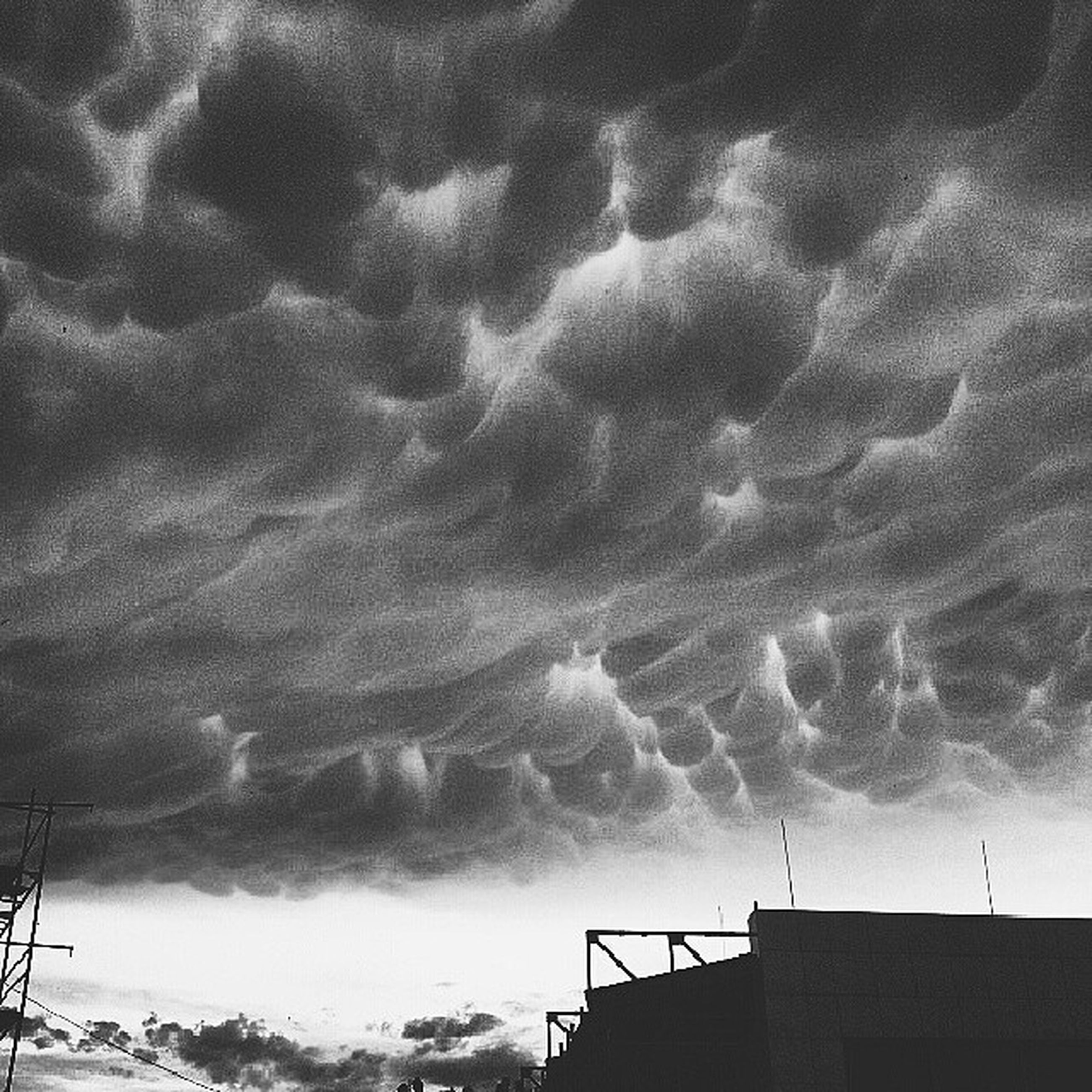 sky, cloud - sky, cloudy, building exterior, weather, built structure, low angle view, architecture, overcast, storm cloud, cloud, nature, house, beauty in nature, scenics, high section, outdoors, silhouette, roof, dusk