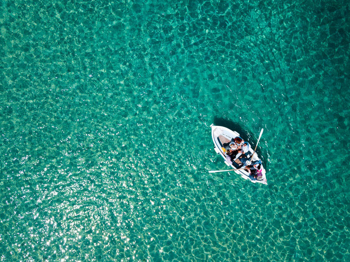 Aerial View Of People Sailing Boat In Sea