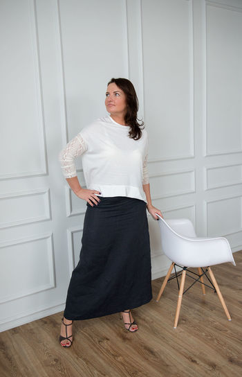 Chair Adult Adults Only Beautiful Woman Chair Day Full Length Indoors  Interior Lifestyles Looking At Camera One Person One Woman Only People Portrait Real People Standing Studio Photography Studio Shot Summer Fashion Well-dressed White Background Women Young Adult Young Women Fashion Stories