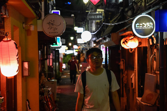 Golden Gai Japanese  Shinjuku Adult Bars Casual Clothing City Communication Drinking Entertainment District Front View Illuminated Lantern Lighting Equipment Men Night Nightlife One Person Outdoors People Real People Standing Street Photography Text