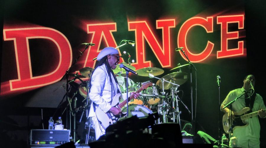 Chic featuring Nile Rodgers @ O2 Academy - Glasgow 23/03/2015 Adult Arts Culture And Entertainment Business Chic Clothing Communication Hat Illuminated Men Neon Night Nilerodgers Occupation One Person Performance Stage Stage - Performance Space Standing Text Western Script Working