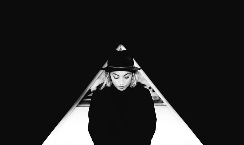 Young girl in hat between triangle, isolated on the black background, art picture Adult Adults Only Black Background Day One Person One Woman Only Only Women People Portrait Young Adult Fresh On Market 2017