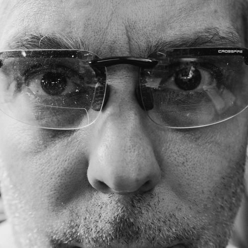 Glasses Adult Beard Body Part Close-up Contemplation Eyeball Front View Headshot Human Body Part Human Eye Human Face Looking At Camera Males  Mature Men Men Mid Adult Mid Adult Men One Person Portrait Real People Serious