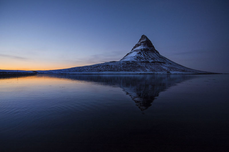Kirkjufell mountain in Iceland Kirkjufell Kirkjufell Mountain Iceland Mountain Mountain Range Mountain Peak Water Reflection Sky Tranquil Scene Tranquility Scenics - Nature Beauty In Nature Lake Nature No People Waterfront Sunset Idyllic Outdoors Cloud - Sky Non-urban Scene Winter Travel Destinations Snowcapped Mountain