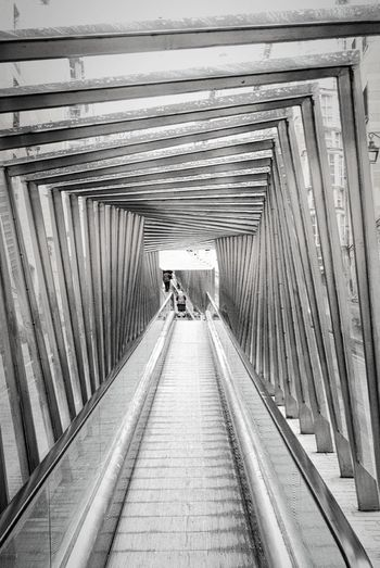 Architecture Black And White Built Structure Diminishing Perspective Escalator Long Modern The Way Forward Transportation Vanishing Point Walking Escalators Ladyphotographerofthemonth Abstract The Architect - 2016 EyeEm Awards Your Design Story Fine Art Photography On The Way Color Palette Beautifully Organized