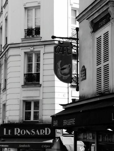 Building Exterior Window City Built Structure City Street Architecture Outdoors Text No People Day Sacre Coeur Touristspot France Paris Montmartre Street City Building Streetsign Signs Restaurants Cafe