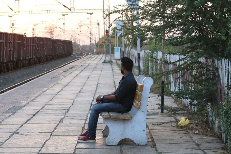 Sitting Adult One Person Full Length People Day Outdoors Tree Young Adult One Man Only Adults Only City Only Men Sky Waiting For A Train People And Places Travel Photography Mature Adult Eyeem India Taking Photos DSLR Photography EyeEm Adult Nature Human Body Part The Photojournalist - 2017 EyeEm Awards Live For The Story