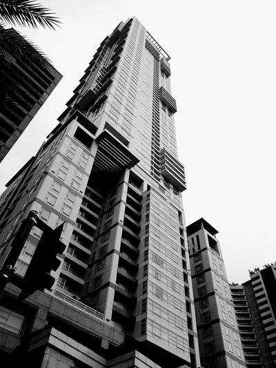 Autobot or Decepticon? Architecture Skyscraper Low Angle View Building Exterior Taking Photos Mobilephotography Mobilephotographyph Looking Up Streetphotography Street Photography Built Structure Perspectives Cityscape Streetphotography_bw Monochrome Photography Monochrome Blackandwhite Black And White Architecture EyeEm Manila Eyeem Philippines Urban Photography Urbanphotography Lookingup (Huawei Mate 9)