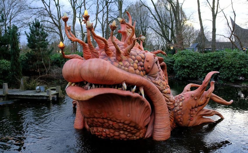 Attraction theme park the Efteling, Kaatsheuvel, the Netherlands Water Representation Statue Sculpture Art And Craft Tree Nature Day No People Lake Plant Human Representation Creativity Outdoors Park Park - Man Made Space
