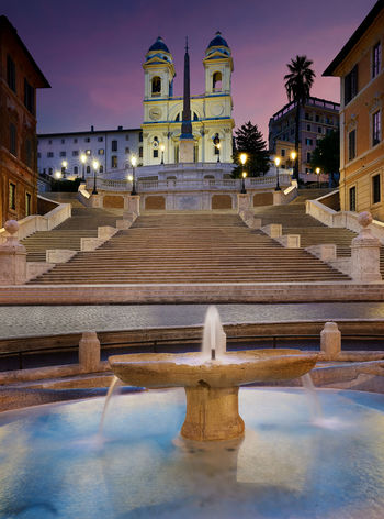 Piazza di Spagna, at the bottom of the Spanish Steps, is one of the most famous squares in Rome. Architecture Buildings Church City Cityscape Dawn Europe Fountain Italian Italy Night Piazza Di Spagna Plazza Religion Roma Rome Spanish Spanish Steps Stairs Steps Street Sunrise Sunset Tranquility Water The Architect - 2017 EyeEm Awards