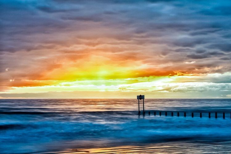 Sea Water Sky Sunset Cloud - Sky Scenics Beauty In Nature Horizon Over Water Nature Tranquil Scene Tranquility No People Beach Idyllic Outdoors Wave Day