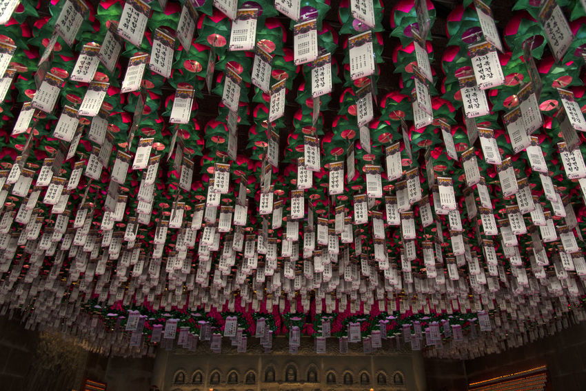 view of Bomunsa, a famous Buddhism temple at Seokmodo in Ganghwado, Kimpo, Gyeonggido, South Korea Bomunsa Buddhism Temple Seokmodo South Korea A Abundance Architecture Belief Buddhism Building Built Structure Communication Day Ganghwado Indoors  Large Group Of Objects Low Angle View Message No People Non-western Script Place Of Worship Religion Religious  Script Spirituality Temple Text