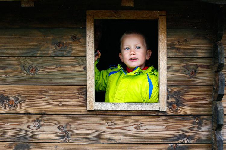 Cute boy looking though window