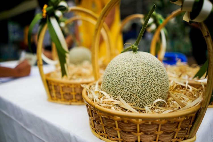 Close-up of fruits in basket on table