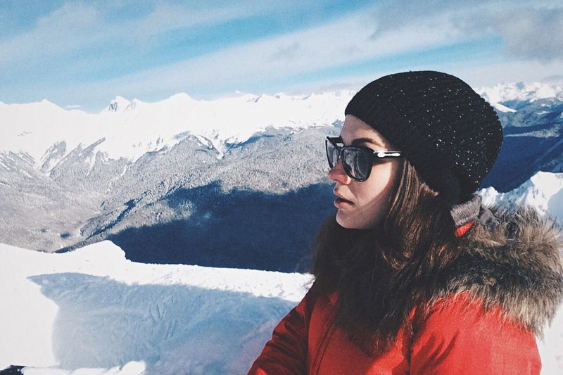 Woman Wearing Warm Clothing On Mountain During Winter