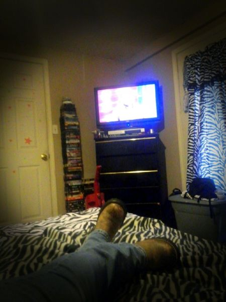 Interior Views Relaxing Hanging Out Tv Television Boots Zebra Print Dresser Door Bed Bedview This is the view from my eyes when i get to watch tv and relax on my bed in my room. 😉