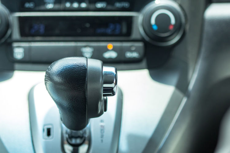 Close-up of gearshift in car