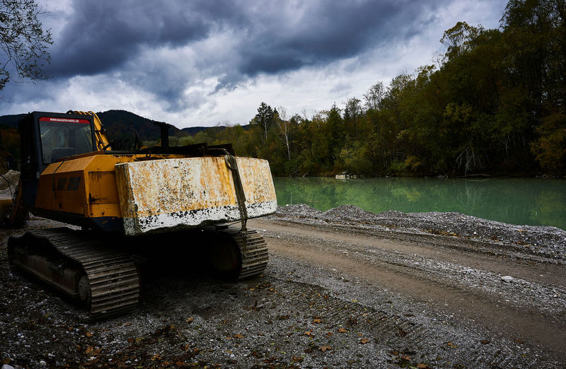 Abandoned vehicle on land against sky