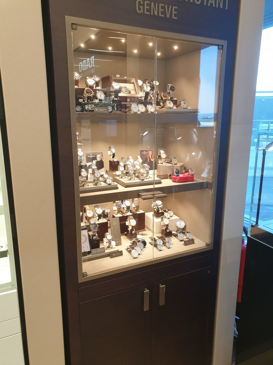 glass - material, transparent, illuminated, window, no people, indoors, food and drink, business, reflection, domestic room, night, modern, cabinet, large group of objects, container, bottle, household equipment, appliance, choice, furniture, display cabinet, luxury
