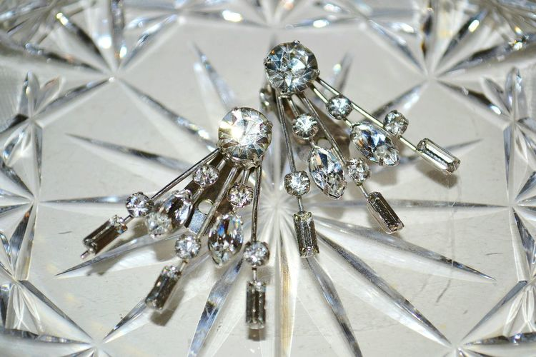 Close-up of crystal brooch pins
