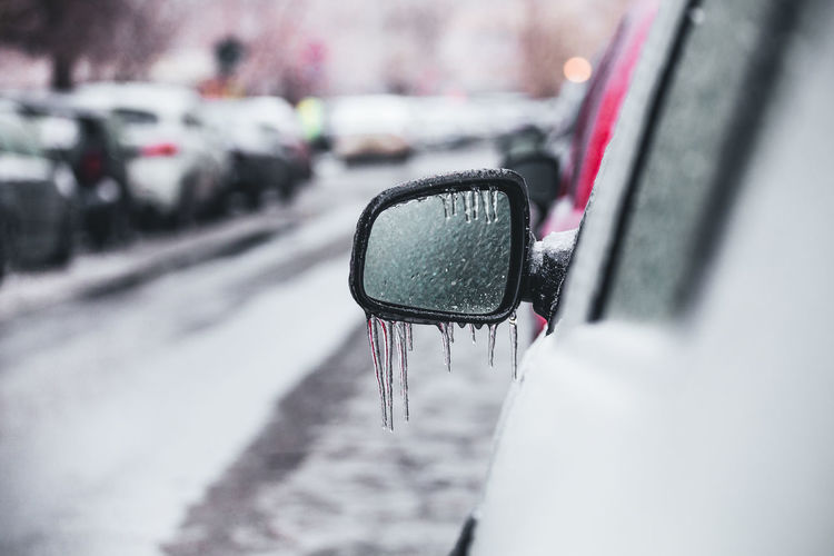 Close up of a car side mirror covered with ice and icicles Mode Of Transportation Transportation Car Motor Vehicle City Land Vehicle Street Road Day Architecture Selective Focus Snow Winter Travel Vehicle Interior No People Reflection Wet Side-view Mirror Outdoors Rain RainDrop Vehicle Mirror Freezing Rain Frost