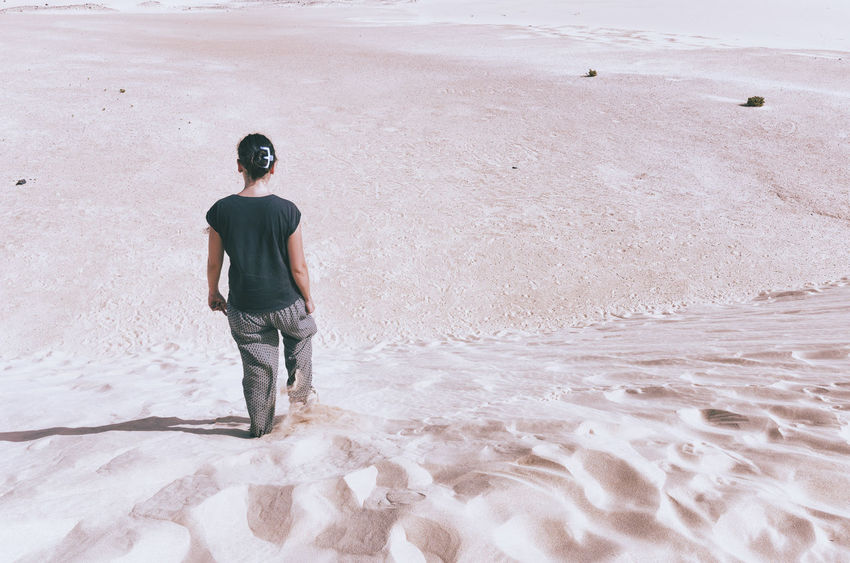 Woman is walking in the sand dunes in the Natural-park, Corralejo , Fuerteventura, Canary Islands, Spain. Alone Backward Corralejo, Fuerteventura Desert Deserts Around The World Dusk Fuerteventura Holidayschooltour Idyllic Island Lost Natural No Face One Person Paradise Park Sand SPAIN Summer Travel Vacations Walking Warm
