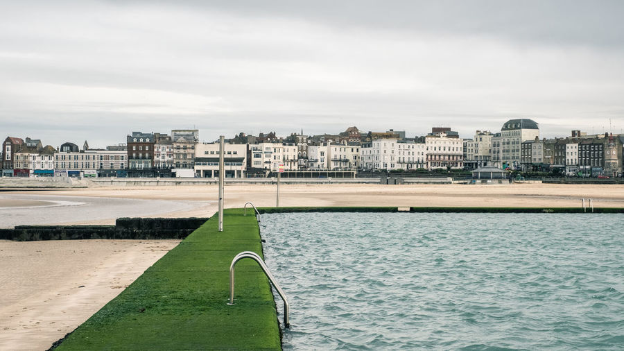 The Beach & Boating Pool, Margate, Kent, UK Margate Kent UK Beach Sands Boating Pool Seaside Cloudy Day Cloudy Green Coast Seafront Outdoors Cloud - Sky No People Day Water Sky Built Structure