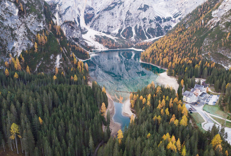High angle view of lago di braies amidst trees and mountains
