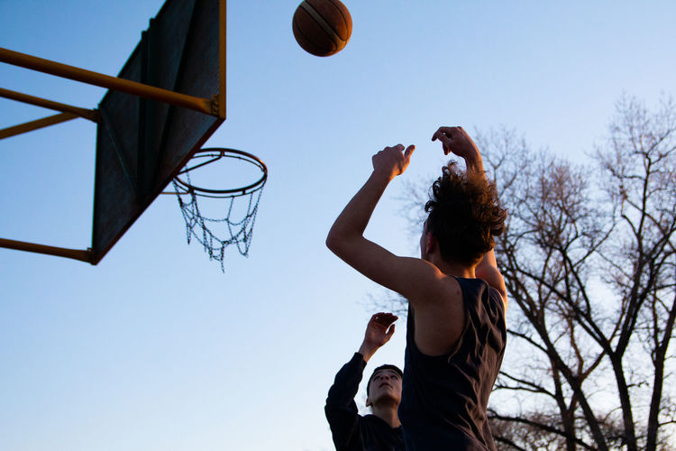 Portrait of teenager boys playing basketball