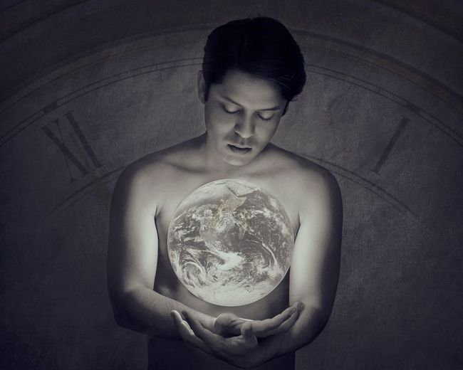 Self portrait. Saving the earth! Saving The World Earth One Person Indoors  Waist Up Holding Front View Shirtless The Creative - 2018 EyeEm Awards Young Adult Sphere Lifestyles Digital Composite Crystal Ball Portrait Real People