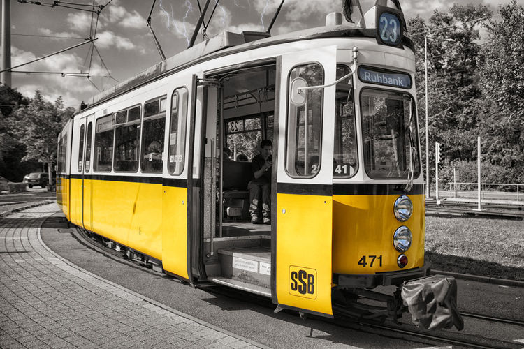 Yellow train on street in city