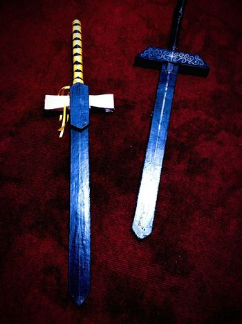 The two swords I made for my brother's school activity. It doesn't look refined at all cause I only made it in one night 😂To make it sturdy, I wasted a lot of glue sticks 😂 it made him feel like Kirito SwordArtOnline Cardboard Art And Craft Black Recycling Recycled Materials Craft Brother Allnight Procrastinating No People Red Close-up Day Indoors  Sword