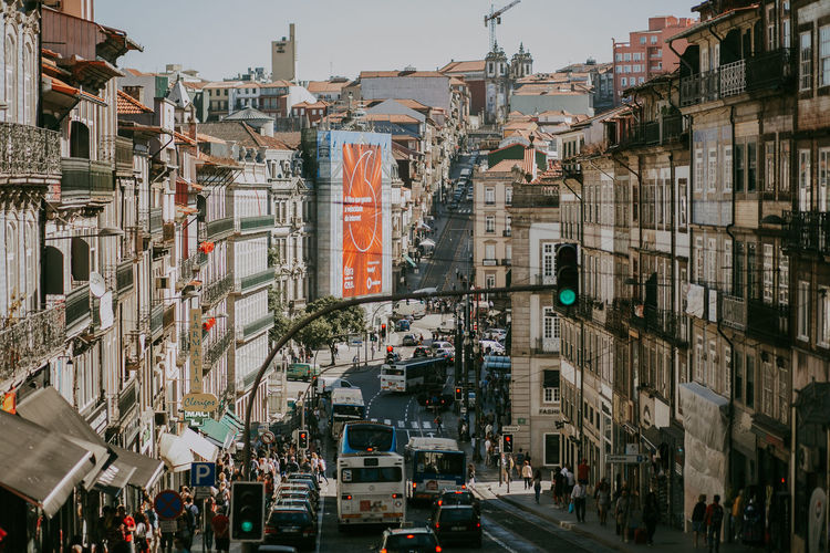 Building Exterior Architecture Built Structure City Building Street City Life Transportation Mode Of Transportation Day Road Land Vehicle Crowd City Street Lifestyles Porto Portugal Streetphotography Busy Street Travel Destinations Apartment Cityscape