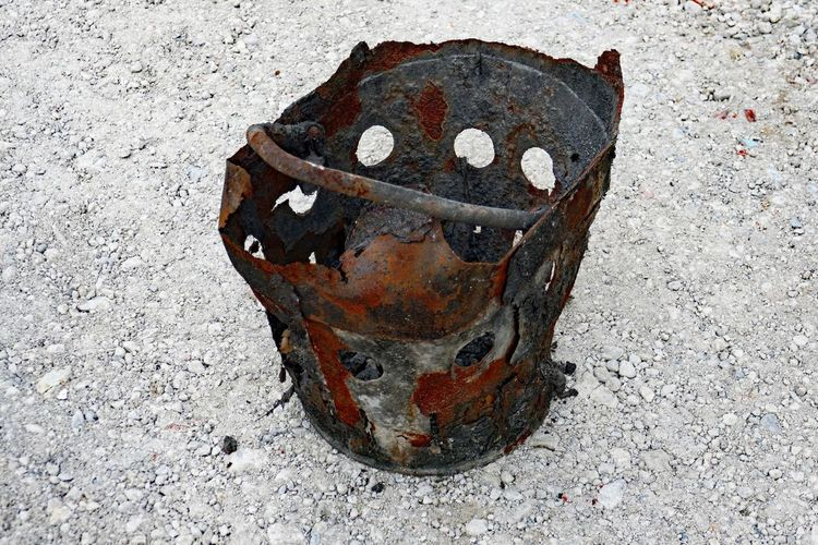 Bad Condition Bucket Close-up Day Gravel Road Heavy Duty Holes Metal No People Old Run-down Rusty Weathered