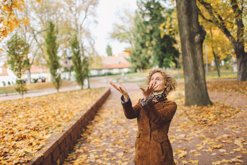 Adult Adults Only Autumn Autumn Beautiful People Beauty Blond Hair Change Colors Curly Hair Girl Human Body Part Leafs Nature One Person Parc Park People Playing Portrait Sunny Day Tree Women Young Adult Young Women