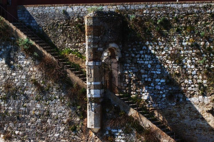 Detail of the wall of the Old Fortress. Architecture Built Structure Day The Past History No People Old Old Ruin Wall Bridge Damaged Outdoors Weathered Connection Run-down Abandoned Ruined Deterioration Stone Wall Gate Fortress Fortress Wall Wall Wall - Building Feature