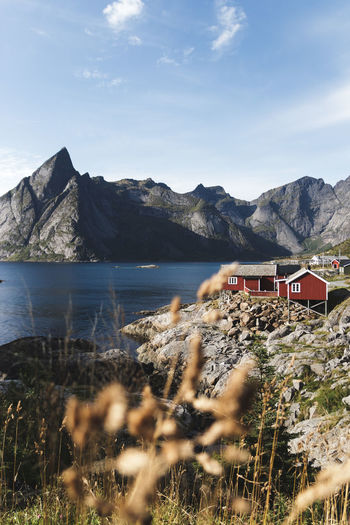Lofoten. Autumn Norway Architecture Beauty In Nature Built Structure Cloud - Sky Day Focus On Background House Lake Lofoten Mode Of Transportation Mountain Mountain Range Nature No People Non-urban Scene Outdoors Scenics - Nature Sky Tranquil Scene Tranquility Transportation Water