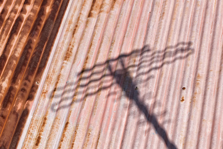 Aerial Full Frame Backgrounds Pattern Rusty Textured  Corrugated Shadow Sunlight Corrugated Roof Abstract Concept Conceptual Metal Day Pink Color Red Textured  Backdrop Technology Signal Lines Old Aerial