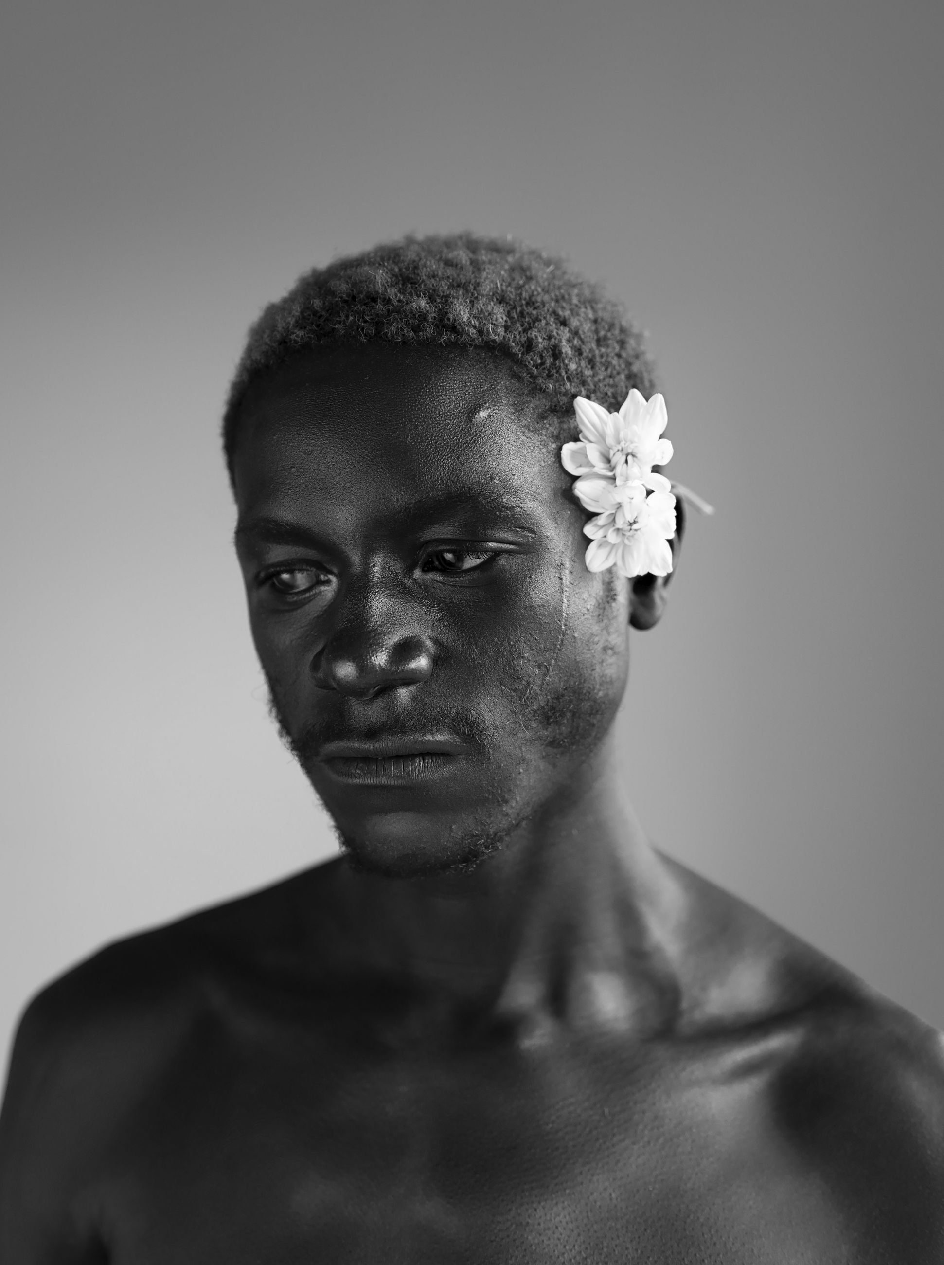 headshot, portrait, studio shot, shirtless, indoors, one person, gray background, front view, gray, young men, young adult, lifestyles, close-up, looking at camera, serious, white background, looking, contemplation