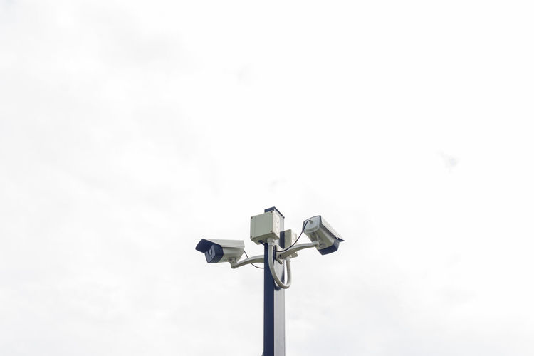 Low Angle View Of Security Camera Against Sky