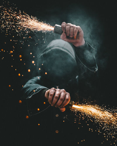 Man Holding Burning Smoke Bomb